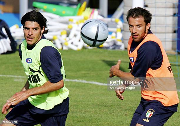 Italy's forward Alessandro Del Piero vies with midfielder Gianluca Zambrotta during a training session in Lisbon 10 June 2004 two days before the...