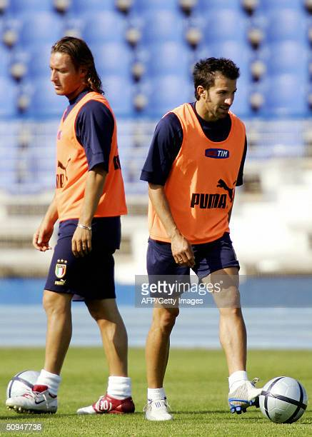 Italy's forward Francesco Totti practices next to teammate forward Alessandro Del Piero during a training session in Lisbon 10 June 2004 two days...