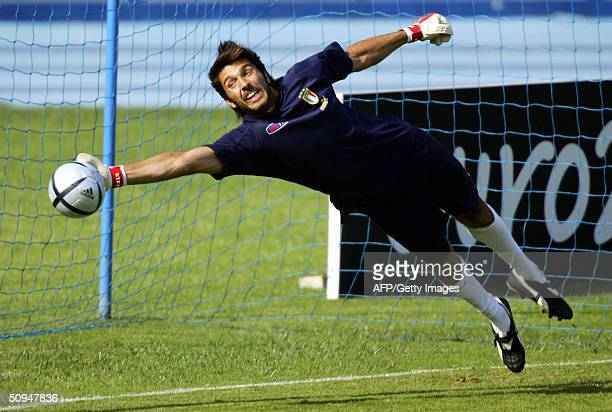 Italy's goalkeeper Gianluigi Buffon tries to stop the ball during a training session in Lisbon 10 June 2004 two days before the start of the 2004...