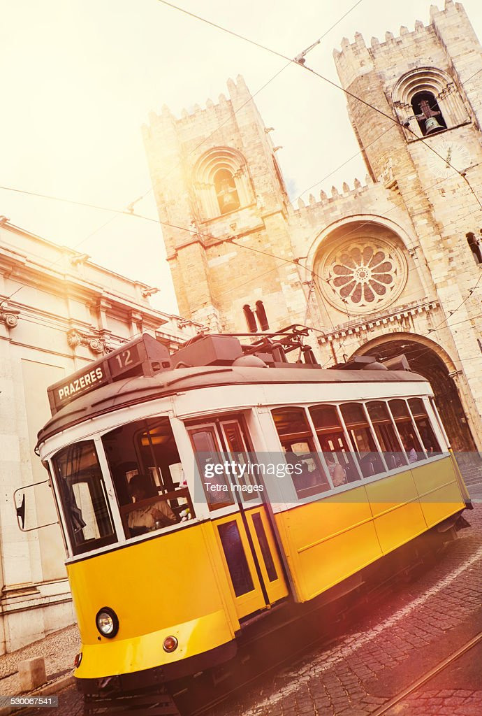 Portugal, Lisbon, Tram in front of Lisbon Cathedral