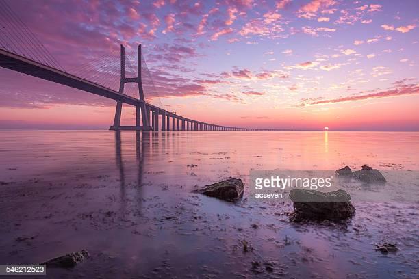 Portugal, Lisbon, Vasco da Gama Bridge silhouetted against morning sky