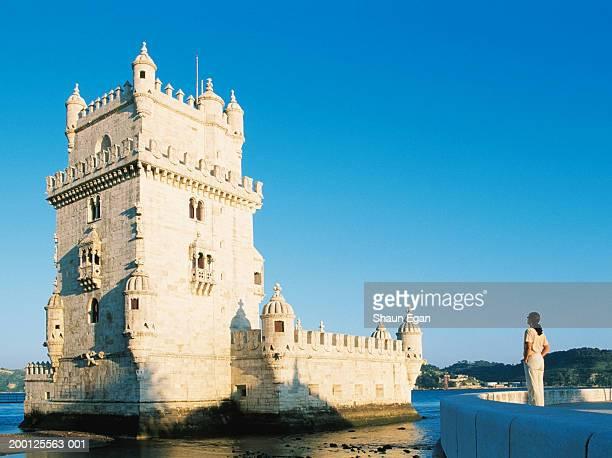 Portugal, Lisbon, woman admiring Tower of Belem