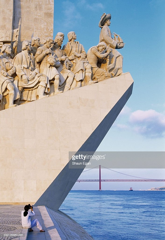 Portugal, Lisbon, woman photographing Monument to the Discoveries : Stock Photo