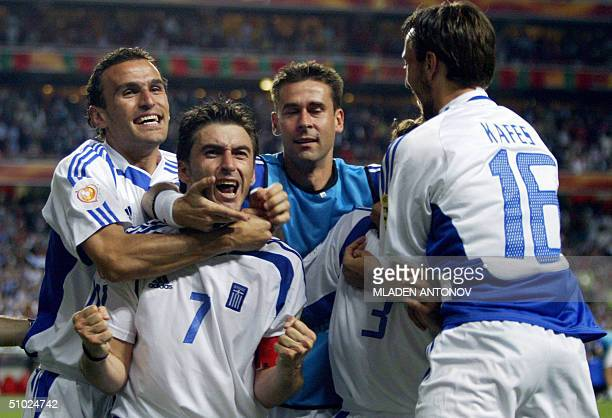 Members of the Greek team celebrate 04 July 2004 at Stadio da Luz in Lisbon after the Euro 2004 final football match between Portugal and Greece at...