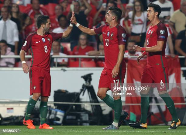 Portugal midfielder Andre Silva celebrates with team mate Portugal midfielder Joao Moutinho after scoring a goal during the FIFA 2018 World Cup...