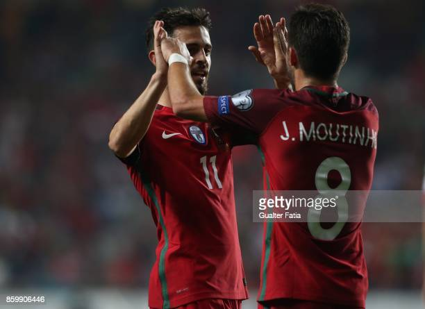Portugal midfielder Bernardo Silva celebrates with teammate Portugal midfielder Joao Moutinho the victory at the end of the FIFA 2018 World Cup...