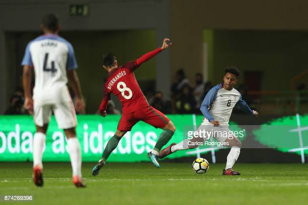 Portugal midfielder Bruno Fernandes vies with United States of America midfielder Weston McKennie for the ball possession during the match between...