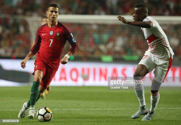 Portugal midfielder Cristiano Ronaldo with Switzerland midfielder Denis Zakaria in action during the FIFA 2018 World Cup Qualifier match between...