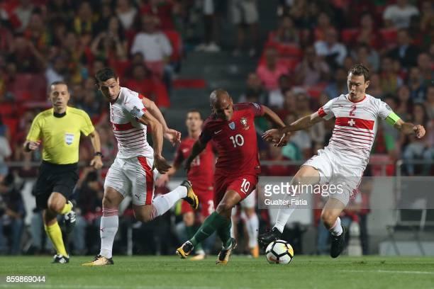Portugal midfielder Joao Mario with Switzerland defender Stephan Lichtsteiner and Switzerland midfielder Blerim Dzemaili in action during the FIFA...