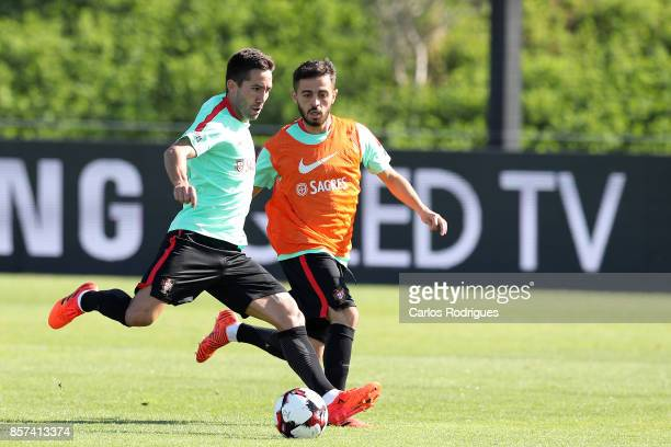 Portugal midfielder Joao Moutinho with Portugal midfielder Bernardo Silva during Portugal Training Session and Press Conference the at Cidade do...