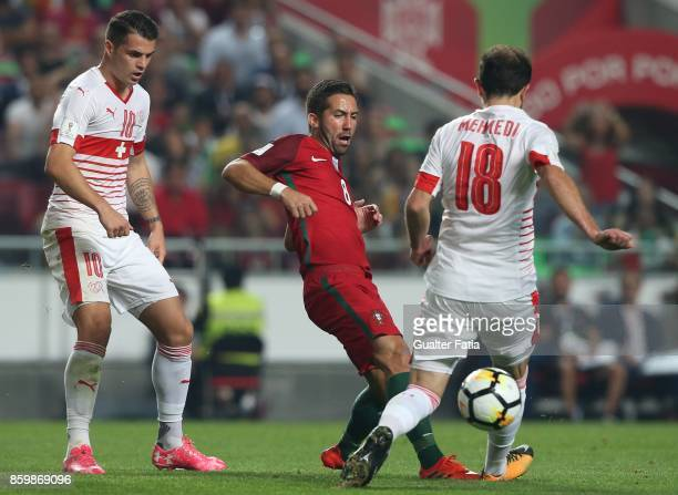 Portugal midfielder Joao Moutinho with Switzerland forward Admir Mehmedi in action during the FIFA 2018 World Cup Qualifier match between Portugal...