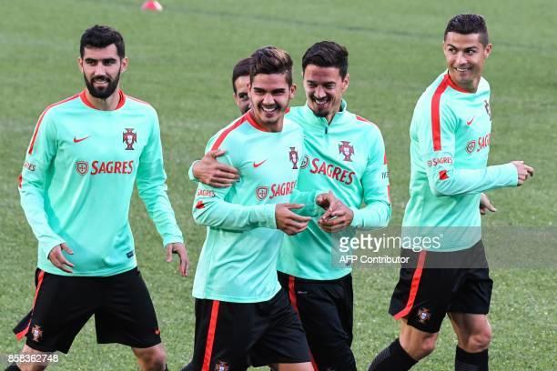 Portugal national football team forward Cristiano Ronaldo forward Andre Silva defender Jose Fonte and teammates joke during a training session at the...