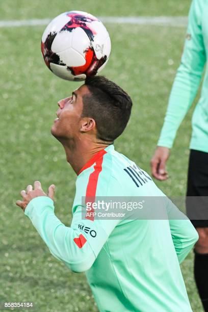 Portugal national football team forward Cristiano Ronaldo head controls the ball during a training session at the Municipal stadium in Andorra la...