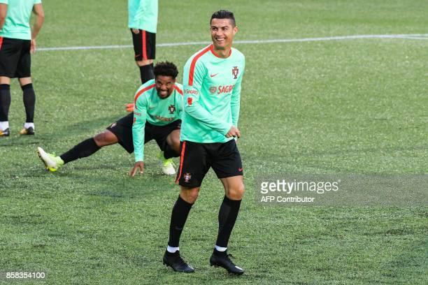Portugal national football team forward Cristiano Ronaldo smiles during a training session at the Municipal stadium in Andorra la Vella on October 6...