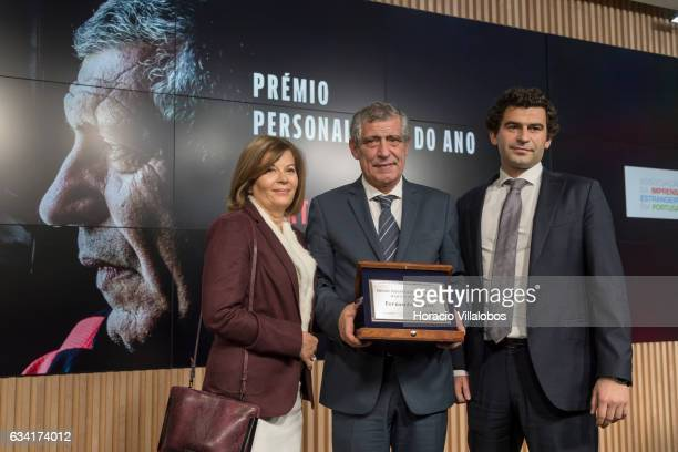 Portugal national soccer team coach Fernando Santos pose for pictures with his wife Guilhermina and son Pedro at the end of the ceremony in which he...