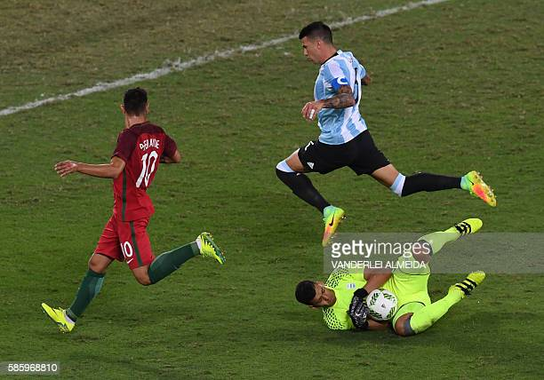 Portugal player Bruno Fernandes vies for the ball with Argentina players goalkeeper Geroinimo Rulli and Victor Cuesta during the Rio 2016 Olympic...