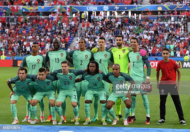 Portugal players and a ball boy line up for the team photo prior to the UEFA EURO 2016 semi final match between Portugal and Wales at Stade des...