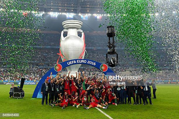 Portugal players and staffs celebrate after their 10 win against France in the UEFA EURO 2016 Final match between Portugal and France at Stade de...