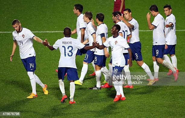 Portugal players celebrate a goal by teammate Ivo during the FIFA Under20 World Cup football match between Portugal and Qatar in Hamilton on June 3...