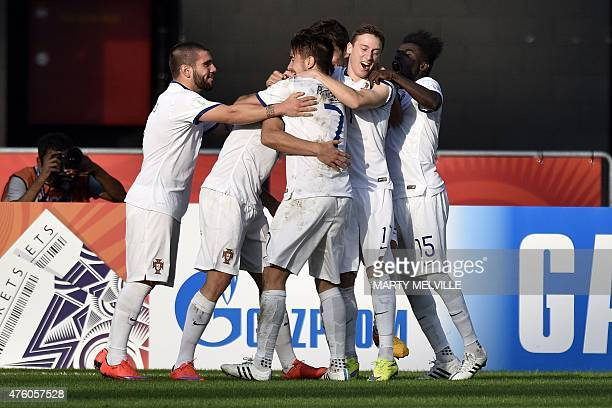 Portugal players celebrate a goal during the FIFA Under20 World Cup football match between Colombia and Portugal in Dunedin on June 6 2015 AFP PHOTO...