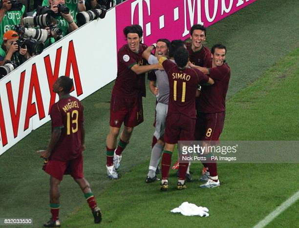 Portugal players celebrate after Cristiano Ronaldo scored the winning penalty