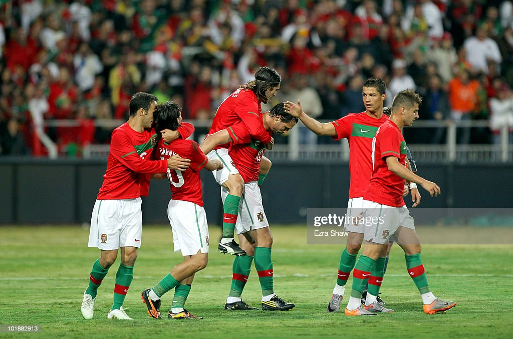 Portugal players celebrate after Hugo Almeida (C) scored a goal during their friendly match against Mozambique at Wanderers Stadium on June 8, 2010 in Johannesburg, South Africa.