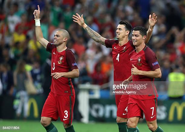 Portugal players celebrate after the penalty shoot out following the UEFA Euro 2016 Quarter Final match between Poland and Portugal at Stade...