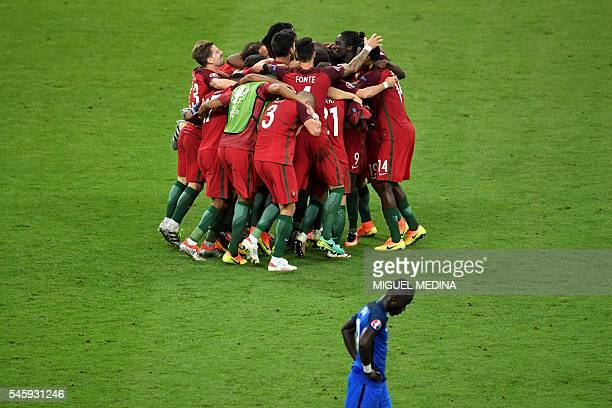 TOPSHOT Portugal players celebrate their 10 win over France in the Euro 2016 final football match between Portugal and France at the Stade de France...