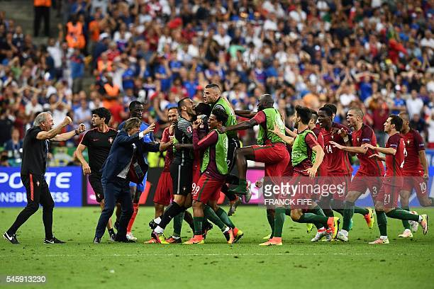Portugal players celebrate their first goal by Portugal's forward Eder during the Euro 2016 final football match between France and Portugal at the...