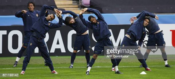 Portugal players including defender José Bosingwa forward Nani and midfielder Deco stretch during a training session on June 6 2008 in Geneva...