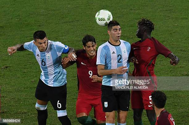 Portugal players Paciencia and Edgar vie for the ball with Argentina players Victor Cuesta and Giannetti Lautaro during the Rio 2016 Olympic Games...
