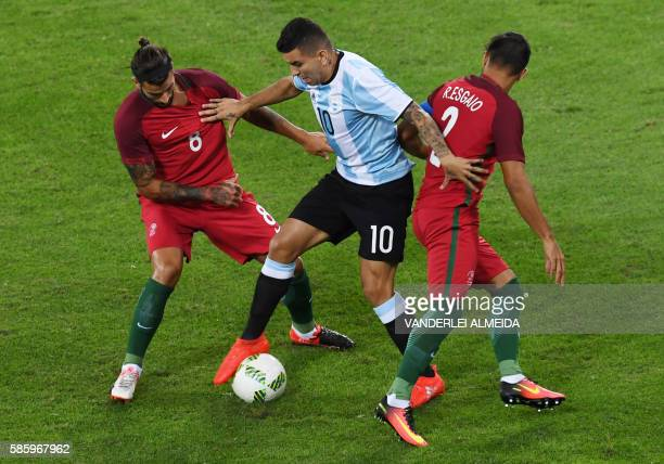 TOPSHOT Portugal players Ricardo Esgaio and Sergio Oliveira vie for the ball with Argentina player Angel Correa during the Rio 2016 Olympic Games...