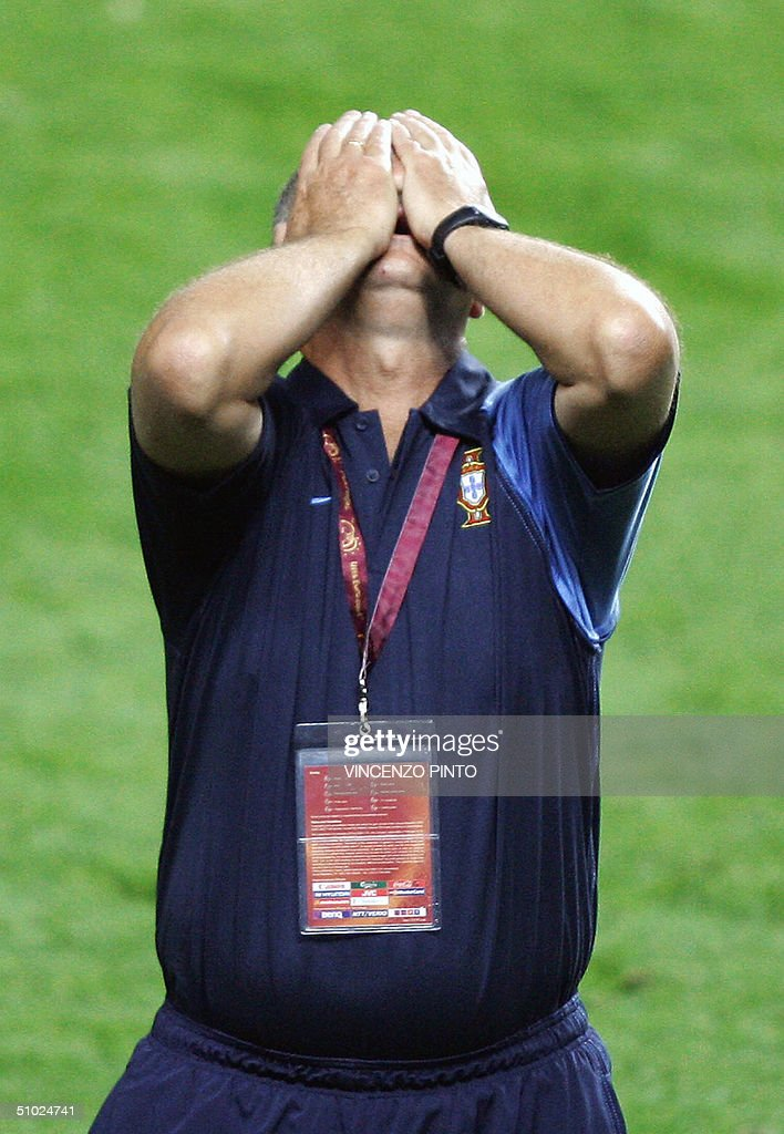 Portugal's Brazilian head coach Luiz Felipe Scolari reacts, 04 July 2004 at the Luz stadium in Lisbon, at the end of the Euro 2004 final match between Portugal and Greece at the European Nations football championship in Portugal. Greece won the match 1 to 0 to be crowned champions of Europe. AFP PHOTO Vincenzo PINTO