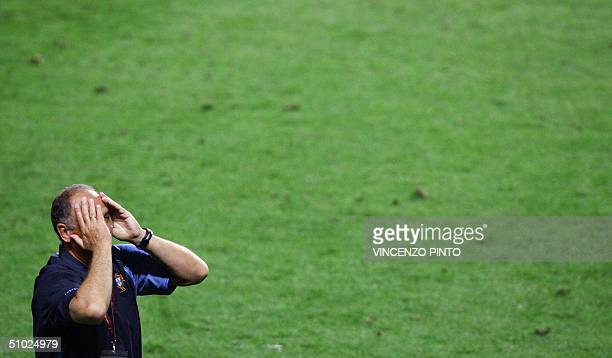 Portugal's coach Luiz Felipe Scolari holds his head in his hands 04 july 2004 at the Stadio Da Luz in Lisbon after the Euro 2004 final match between...