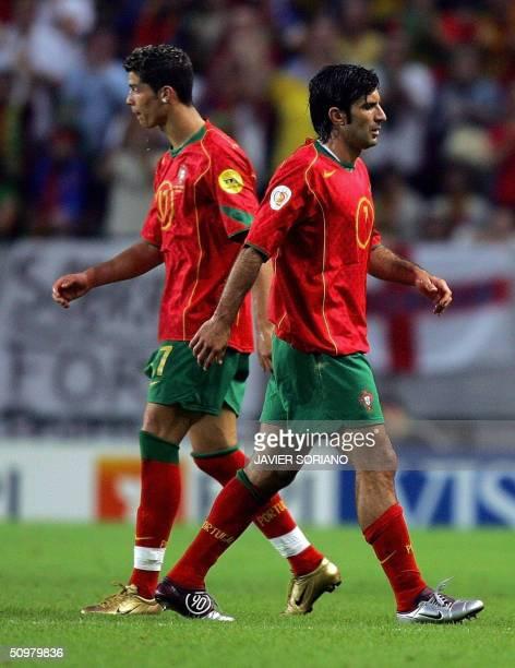 Portugal's forward Luis Figo walks past his teammate forward Cristiano Ronaldo 20 June 2004 at Jose Alvalade stadium in Lisbon during their Euro 2004...