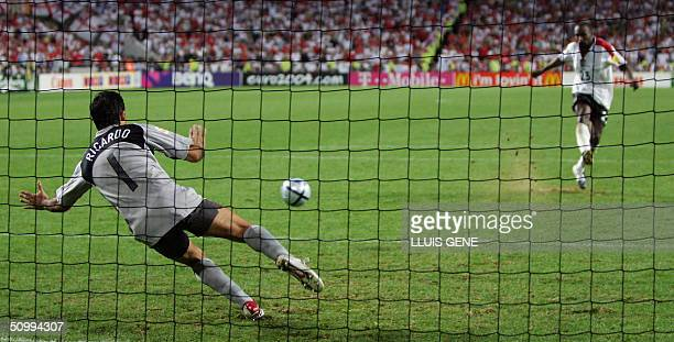 Portugal's goalkeeper Ricardo stops England Darius Vassell's penalty kick 24 June 2004 during their European Nations Championship quarterfinal...
