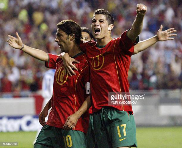 Portugal's midfielder Rui Costa celebrates with his teammate forward Cristiano Ronaldo after scoring a goal 16 June 2004 during their European...