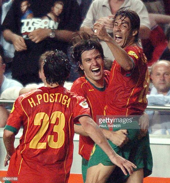 Portugal's midfielder Rui Costa celebrates with his teammates forward Helder Postiga and defender Nuno Valente after scoring during the prolongations...