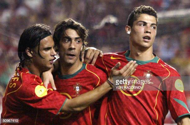 Portugal's midfielder Rui Costa is congratulated by his teammates forward Cristiano Ronaldo and forward Nuno Gomes after scoring a goal 16 June 2004...