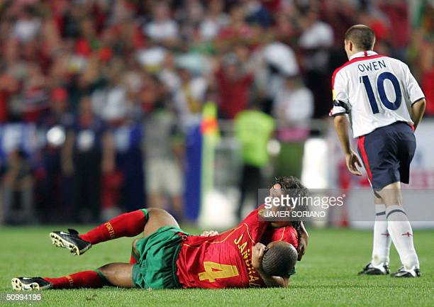 Portugal's midfielder Rui Costa is congratulated by his teammate defender Jorge Andrade next toEngland forward Michael Owen after scoring a goal...