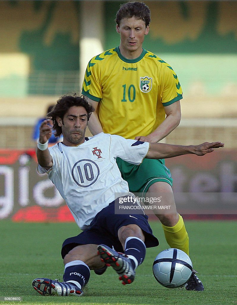 Portugal s Rui Costa fights for the ball