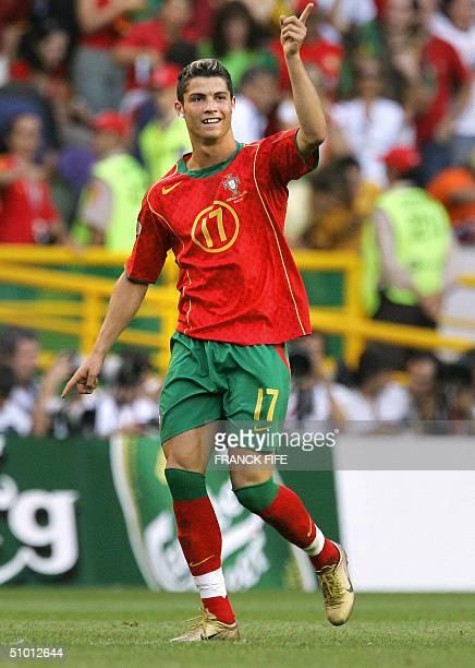 Portuguese forward Cristiano Ronaldo celebrates after scoring on 30 June 2004 at the Alvalade stadium in Lisbon during the Euro 2004 semi final...