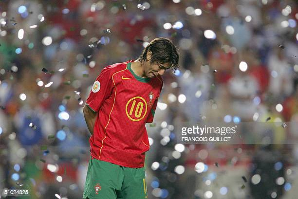 Portuguese midfielder Rui Costa cries 04 July 2004 at the Luz stadium in Lisbon after the Euro 2004 final match between Portugal and Greece at the...