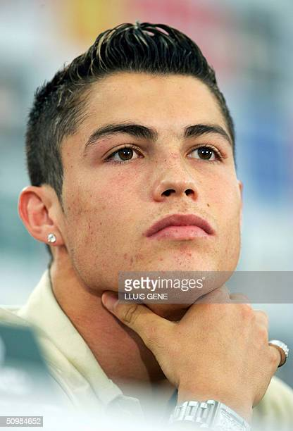 Portuguese player Cristiano Ronaldo gestures during a press conference 22 June 2004 at the Academia Sporting near Lisbon during the European Nations...