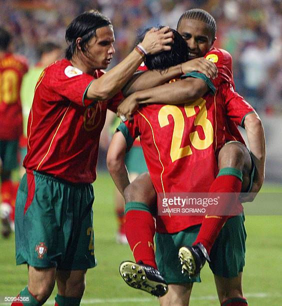 Portuguese players celebrate forwards Nuno Gomes and Helder Postiga Helder Postiga and defender Jorge Andrade after Portugal scores a goal during the...