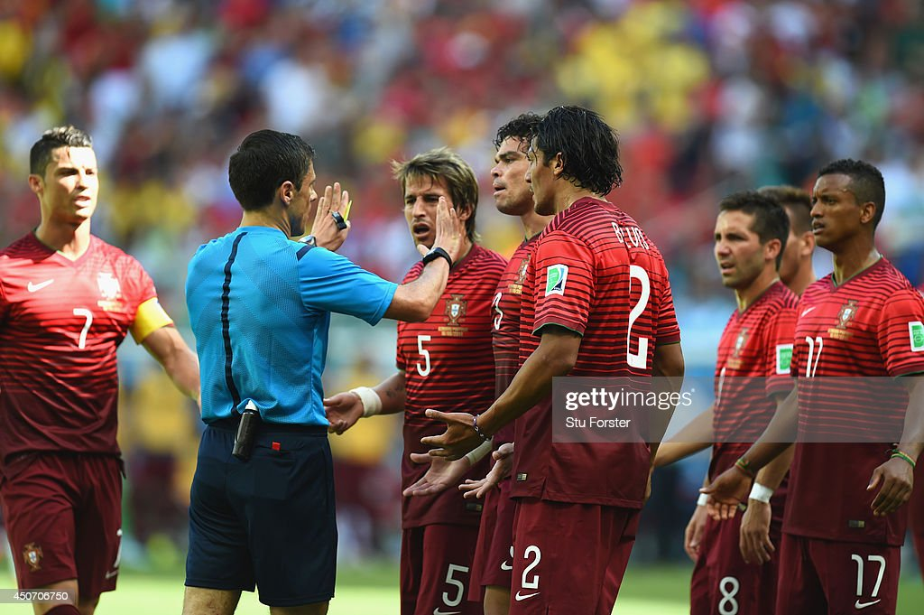 Portugal protest the call of referee Milorad Mazic after awarding a penalty kick to Germany during the 2014 FIFA World Cup Brazil Group G match between Germany and Portugal at Arena Fonte Nova on June 16, 2014 in Salvador, Brazil.