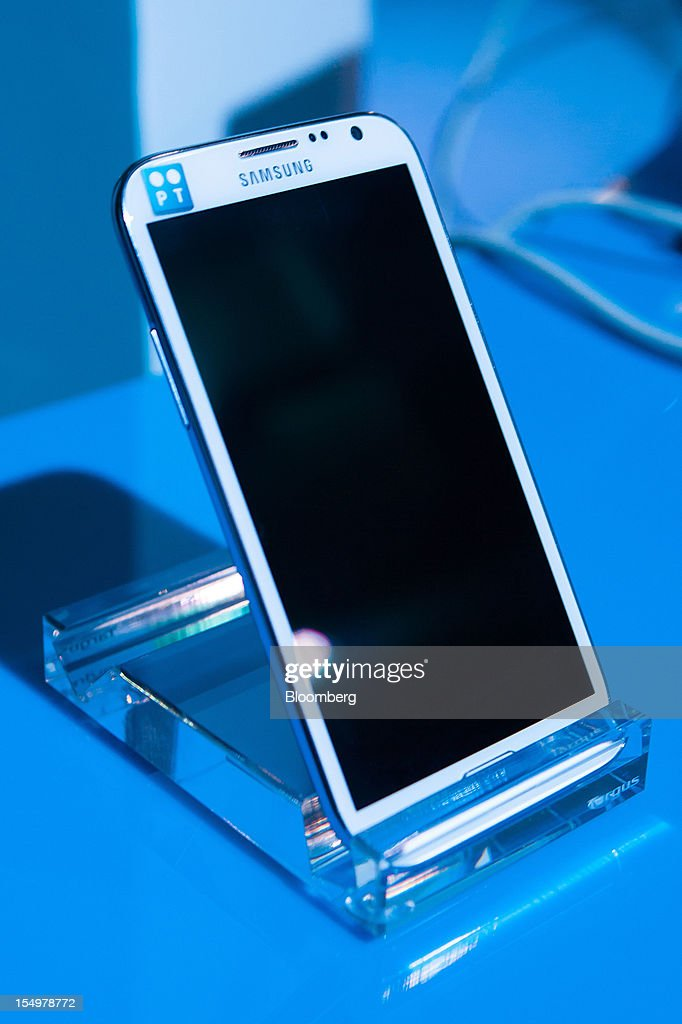 A Portugal Telecom-branded Samsung Galaxy Note II smartphone sits on display in a showroom at the Technology and Innovation conference in Lisbon, Portugal, on Monday, Oct. 29, 2012. 'We believe prices in our domestic market are already low enough,' Portugal Telecom SGPS chief excecutive officer Zeinal Bava said. Photographer: Mario Proenca/Bloomberg via Getty Images
