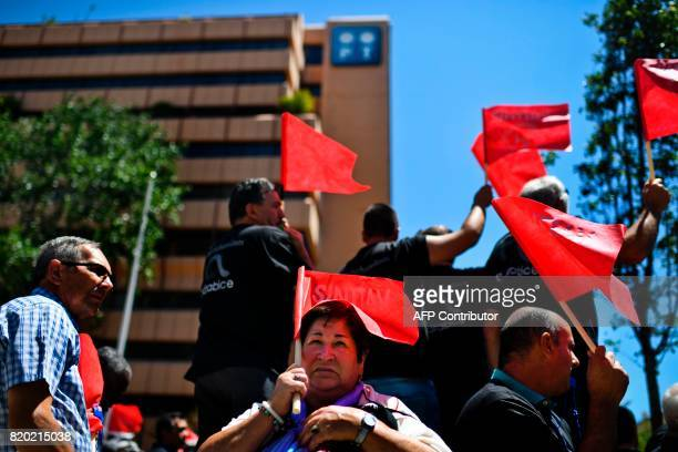 Portugal Telecom's workers gather in front of the company's headquarters during a 24 hours strike to protest against the transfer of 155 workers from...