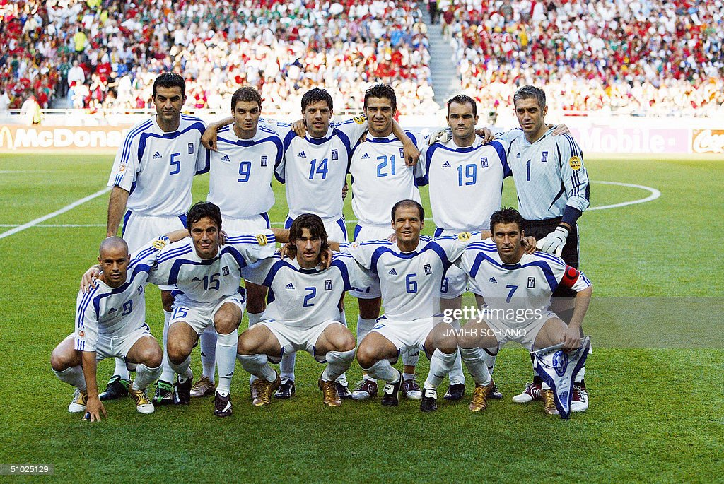 The Greek team pose for the press 04 July 2004 at the Luz stadium in Lisbon prior to the Euro 2004 final match between Portugal and Greece at the...