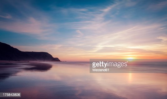 Portugal, View of Praia do Castelejo at sunset